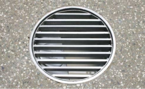 Round drain bar grate installed
